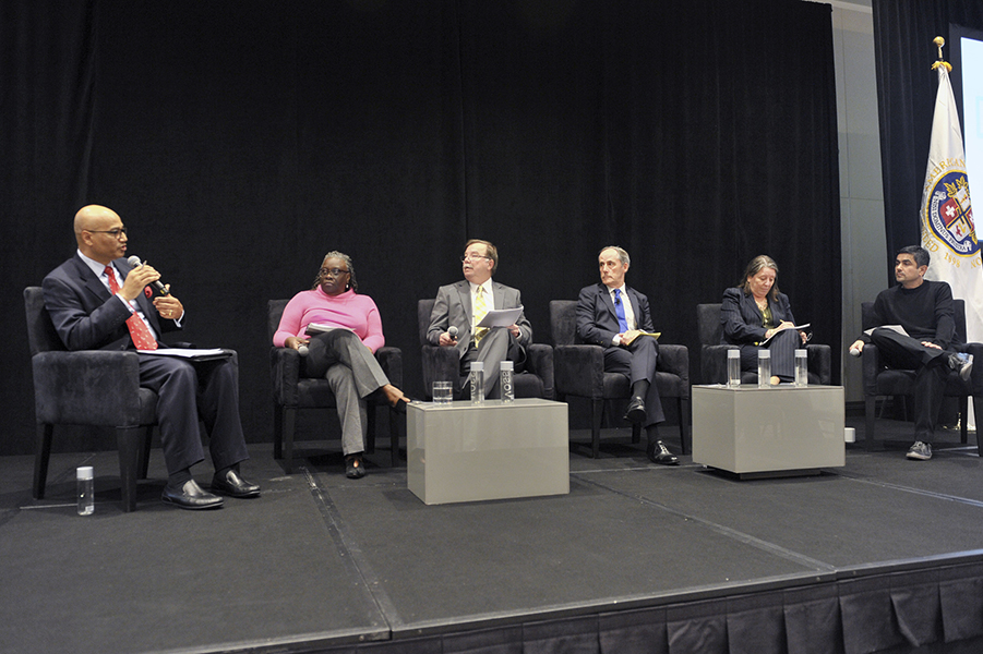 seated panel at executive forum on affordability and innovation