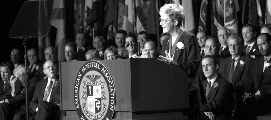 black and white photo of sister Mary speaking at podium