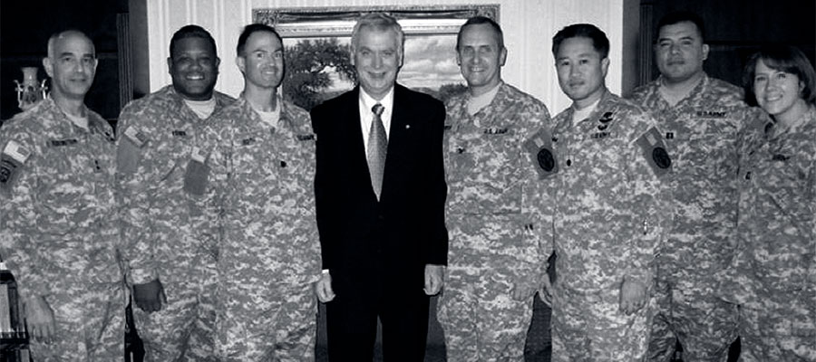 black and white photo of DOlan Redd standing among soldiers
