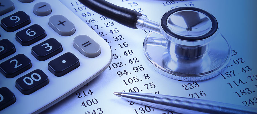 image of calculator, stethoscope and list of numbers