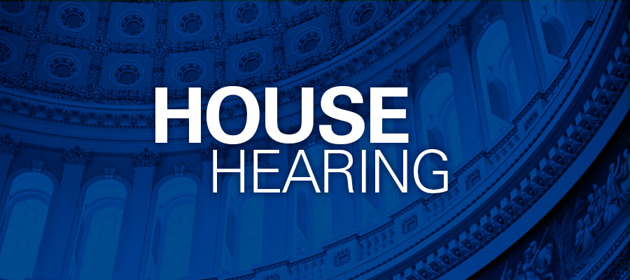 "blue background with white text that says ""House Hearing"""