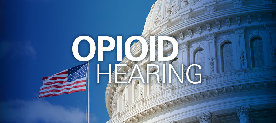 "capitol hill with ""opioid hearing"" in white text"