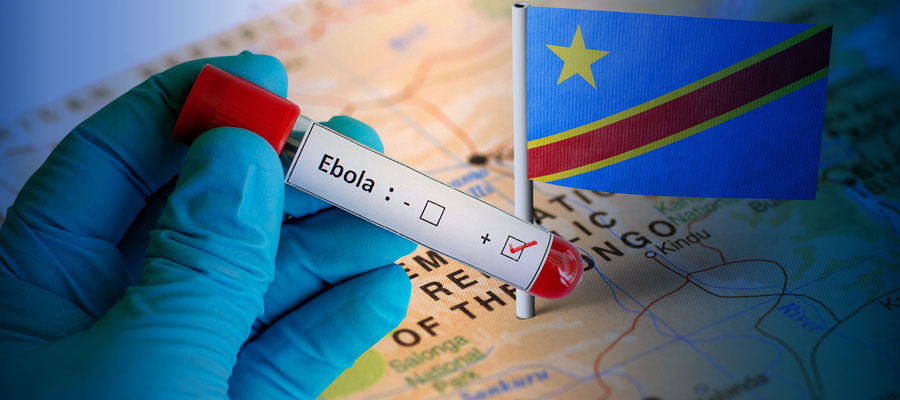 Gloved hand holding vial that says Ebola over a map of the Congo