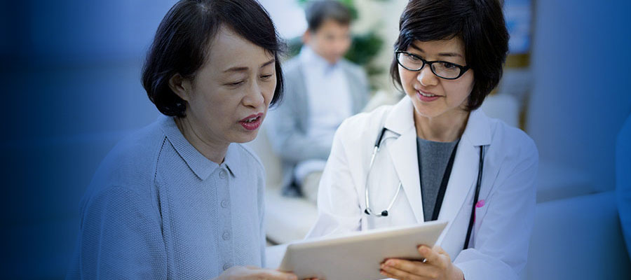 Image of physician showing patient a tablet