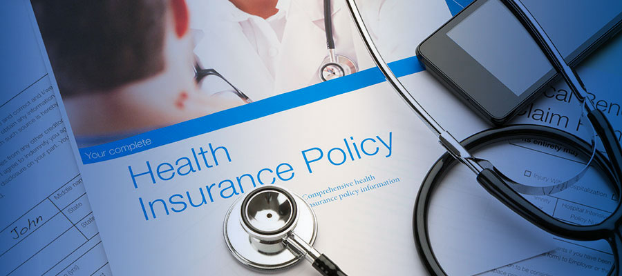 Health insurance policy with stethoscope on it