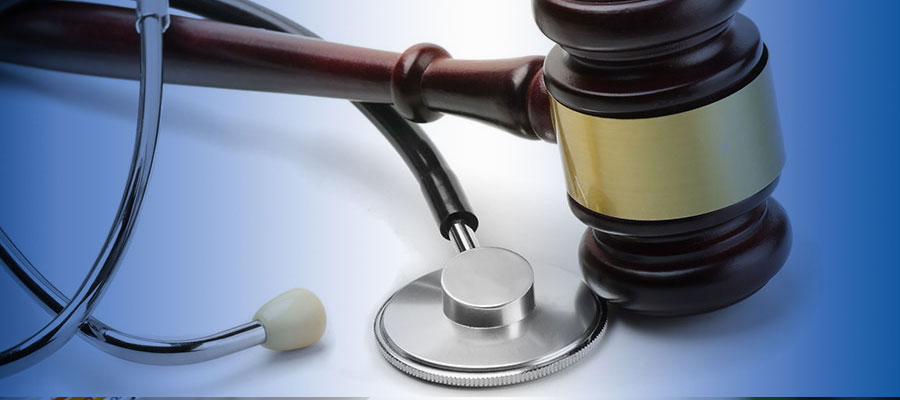 stethoscope and gavel on white surface