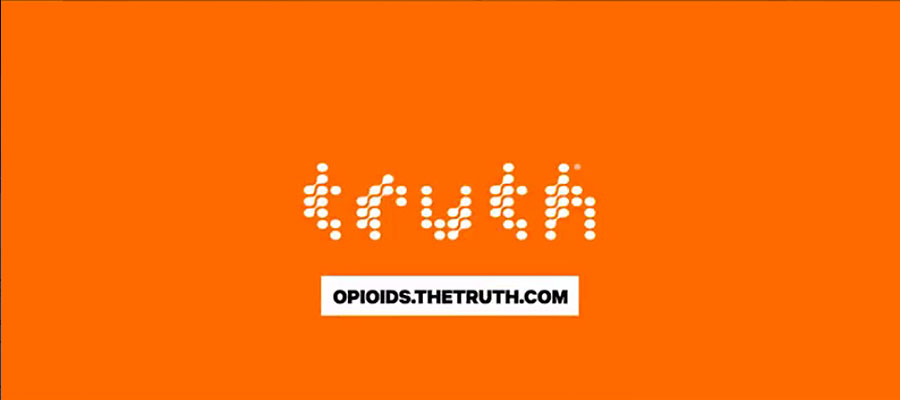 "orange background with white text that says ""truth"" and ""opioids.thetruth.com'"