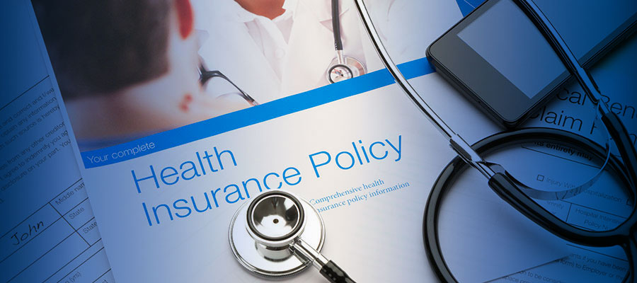 image of health insurance policy with stethoscope on it