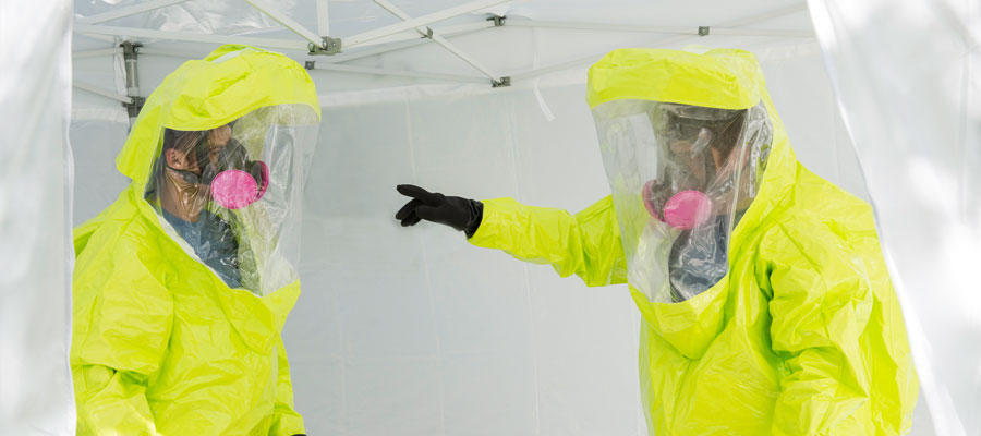 Two men in yellow hazmat suits, biodefense