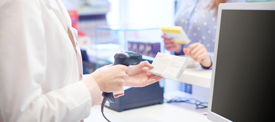 Patient rights drug act, cashier scanning medication over pharmacy counter