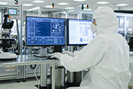 Technology Worker in Clean Suit Performing Research and Development