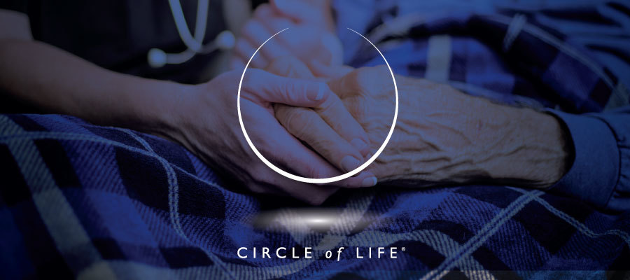Circle of life award: image of elderly hands with the Circle of Life logo