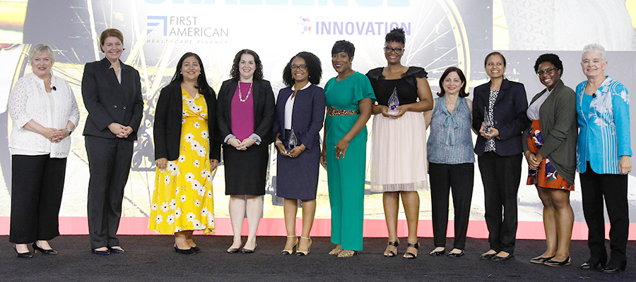 The three winners of the Innovation Challenge on stage with their awards at the 2019 AHA Leadership Summit.