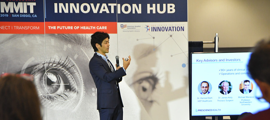 A participant in the AHA Center for Health Innovation Startup Competition at the 2019 AHA Leadership Summit presents his startup idea.