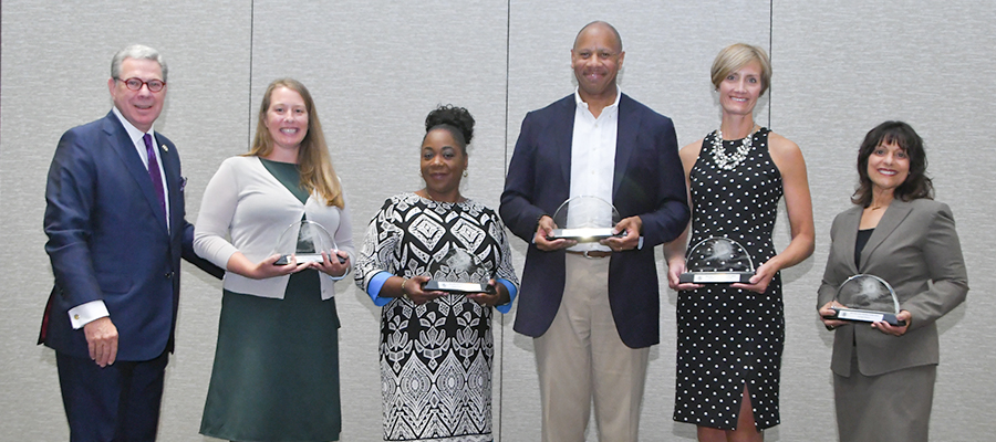 NOVA Award Winners with awards at the 2019 AHA Leadership Summit.