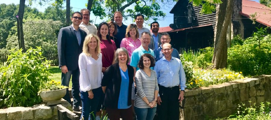 The Physician Leadership Experience group in Atlanta in May 2018 with Carrie Saia (pink shirt) and Erin Locke (maroon shirt).
