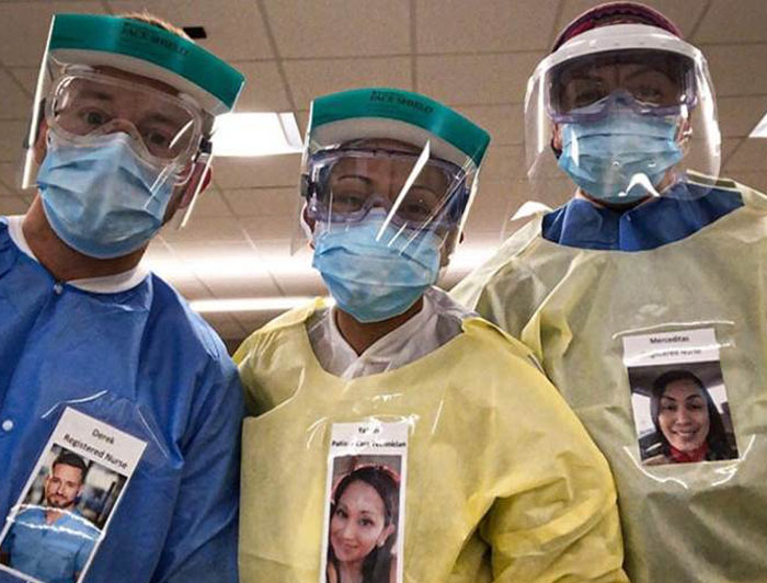 Health Care Workers in PPE Wear Photos of Themselves Smiling