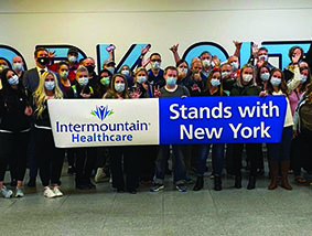 Intermountain Healthcare, Holding a sign - Stand with New York