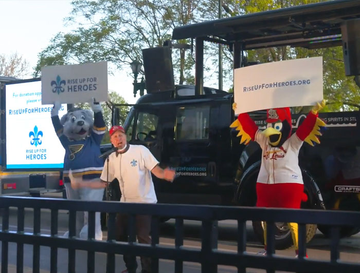 BJC Healthcare, Rise up for Heroes, both team mascots hold up signs
