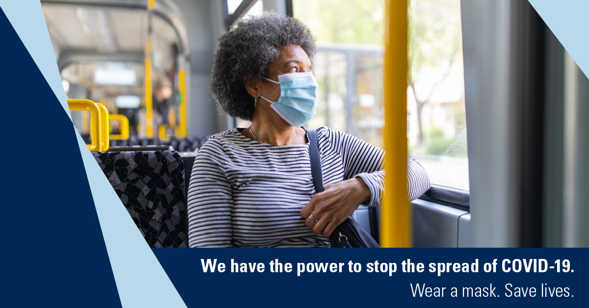 woman riding a bus wearing a cloth mask