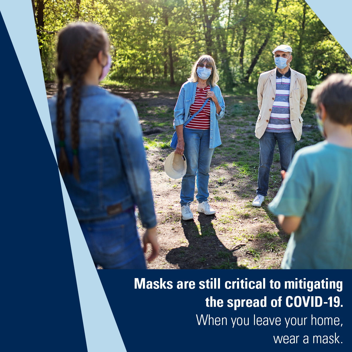 Two adults and three children wearing masks stand in a circle talking. Caption: Masks are still critical to mitigating the spread of COVID-19. When you leave your home, wear a mask.