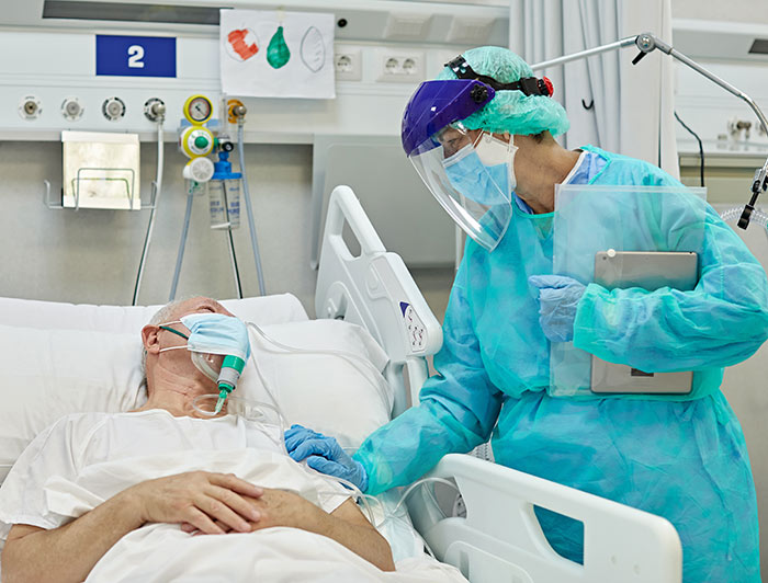Nurse with patien in hospital bed