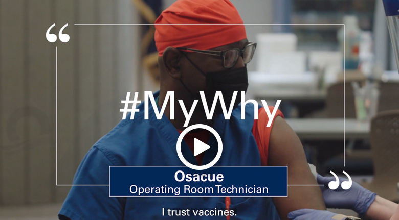 #MyWhy - Health worker Osacue, operating room technician, wearing mask and scrubs, with sleeve rolled up in preparation for COVID-19 vaccination