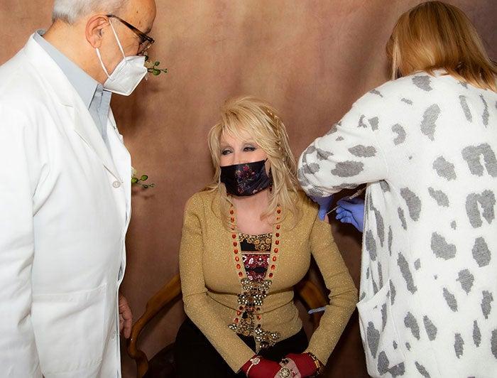 Music legend Dolly Parton receives vaccine from Vanderbilt health worker