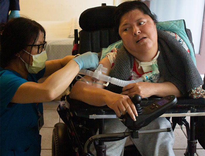 health worker cares for homebound patient