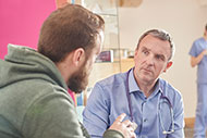 Got a Minute? Tap into Patients' Social Needs. Patient talking to a clinician.