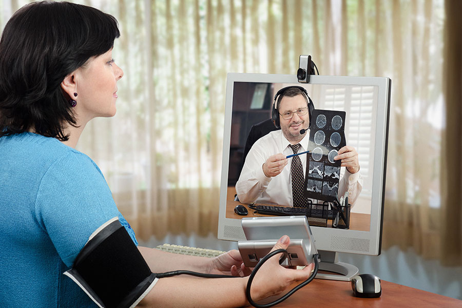 Patient and clinician reviewing health information by telehealth