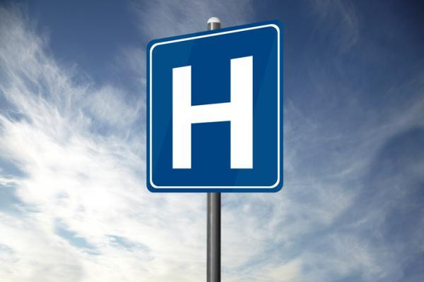 A blue H for hospital sign